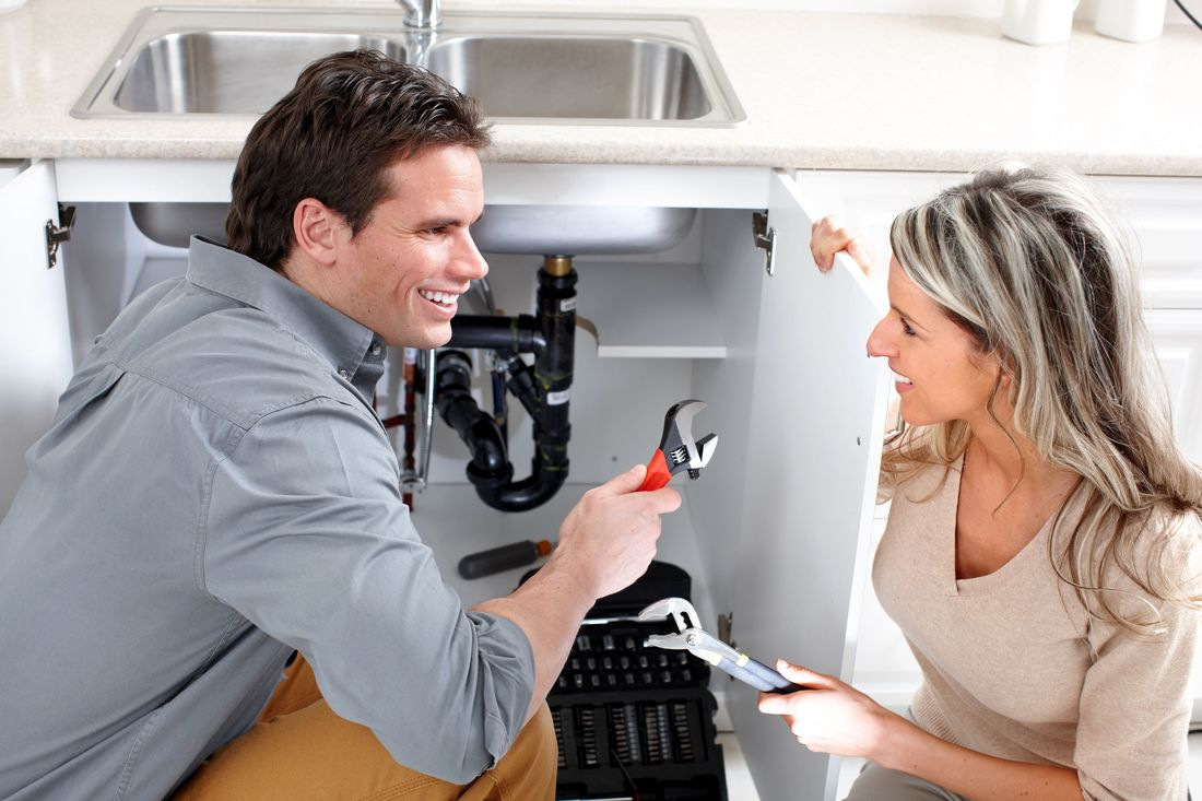 plumber and customer discussing service